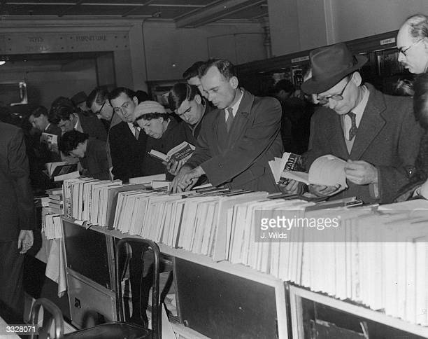 Lunch time bargain hunters in the book department of a London department store during National Book Sales Week