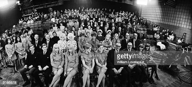Sets of identical twins in a television studio who appeared on the David Frost Programme