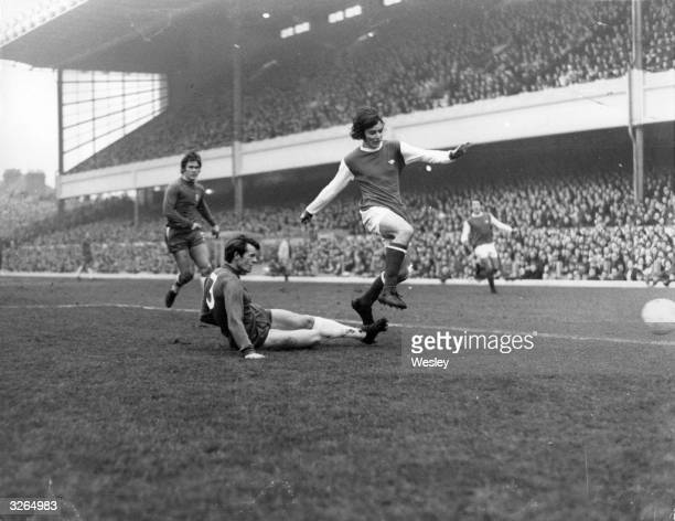 Peter Marinello of Arsenal beats Eddie McCreadie of Chelsea during their league match at Highbury