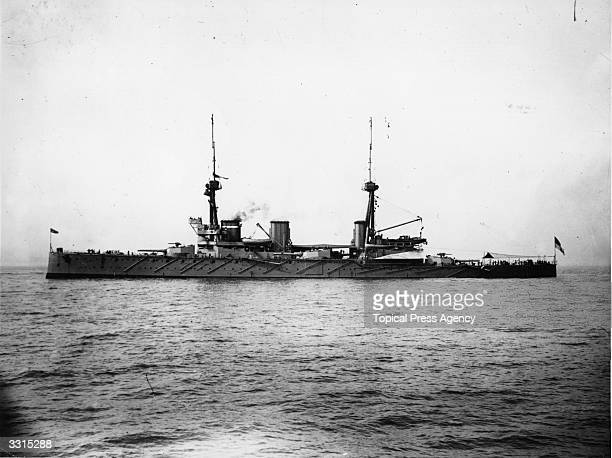 The British battlecruiser HMS Inflexible takes part in a Naval pageant on the river Thames