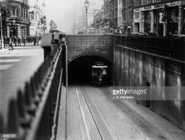 A tram emerges from the Kingsway Tunnel that runs from Southampton Row in Holborn under the Thames to Victoria Embankment
