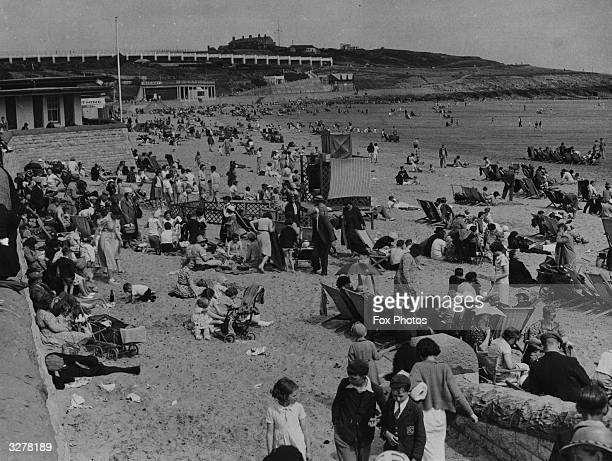 Holiday makers enjoying the sunshine at Barry Island in Wales