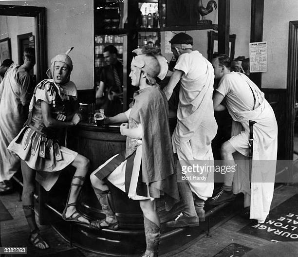 Staff and students at London's Goldsmith's College Art School having a drink at the bar dressed as Romans during their end of term 'Roman Holiday'...