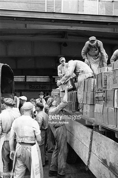 The British army unloading supplies of food at Wunstorf airport near Hanover during the Berlin Airlift.