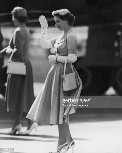 Princess Margaret Rose at London Airport after travelling from Southern Rhodesia with her mother Queen Elizabeth The Queen Mother