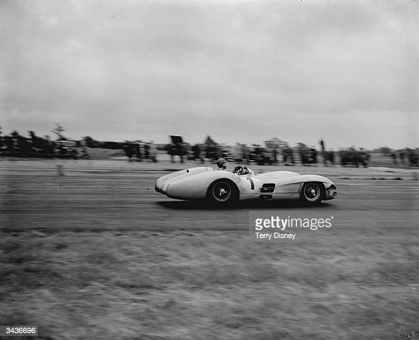 Mercedes racing driver Juan Fangio going around the circuit during the Royal Automobile Club Grand Prix at Silverstone racetrack