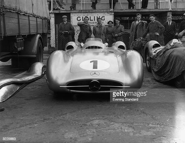 The Mercedes W 196 driven by Juan Manuel Fangio at the Silverstone Grand Prix He finished in fourth place but went on to win the Formula 1 Drivers'...