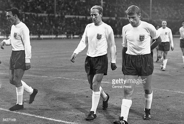English footballers Bobby Charlton Roger Hunt and Jimmy Greaves leave the pitch during England's World Cup match against Mexico at Wembley Stadium...