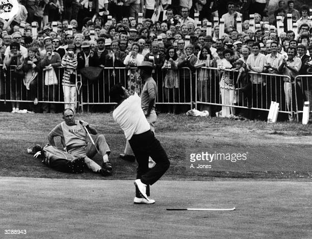 Lee Trevino of the USA flinging his hat in the air in triumph at the 18th hole on winning the Open at Royal Birkdale.