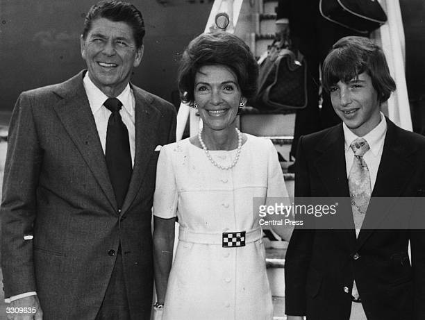 American politician Ronald Reagan Republican Governor of California and former filmstar arriving at Heathrow airport London with his wife Nancy and...