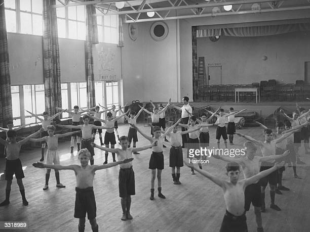 Schoolboys in a Physical Training class in the main hall of Bourne Secondary Modern School Ruislip Middlesex It is Britain's newest day school and...