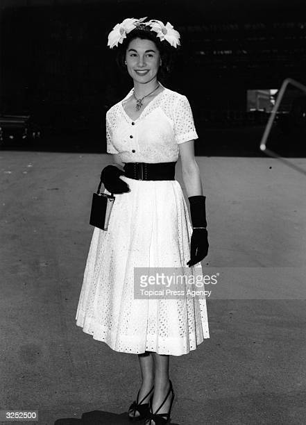 Margaret Sheridan wears a Broderie Anglaise dress with a black straw hat trimmed with Marguerite for the first day of Ascot
