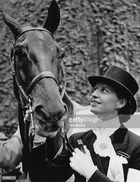 Danish sportswoman Lis Hartel with her silver medal and her mount 'Jubilee' after winning second place in the Grand Prix de Dressage event of the...