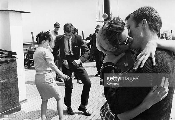 One couple dance the Twist as another kiss on board the steamer the 'Royal Daffodil' during a special crossChannel trip with ten bands on board...