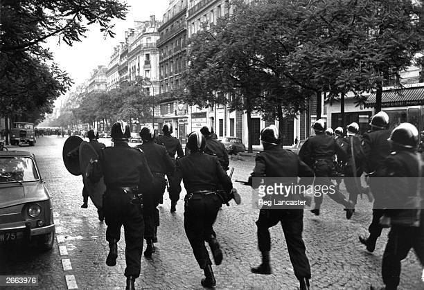 French riot police, the CRS clear the streets of Paris during the student riots.
