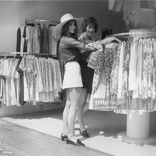 Two young women shopping at a fashionable boutique on King's Road in Chelsea London