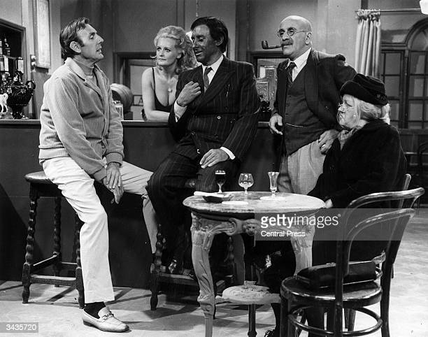 A scene from an election night special featuring Warren Mitchell as 'Alf Garnett' and Eric Sykes Lorna Wilde Spike Milligan and Joan Sims