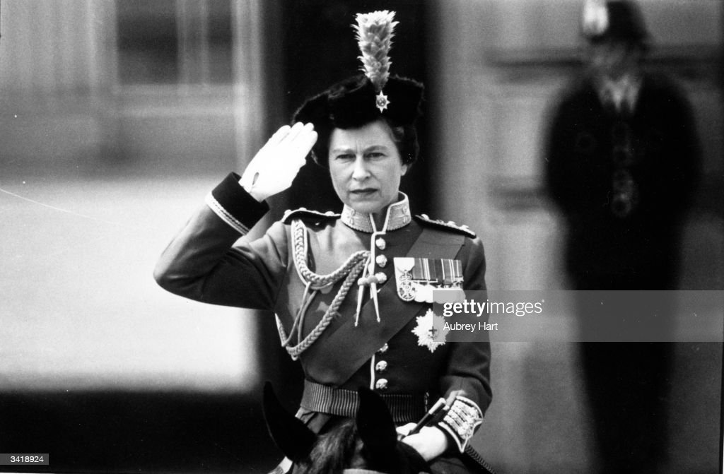 Queen Elizabeth II giving the royal salute during a Trooping of the Colour ceremony at Horse Guard's Parade, London.
