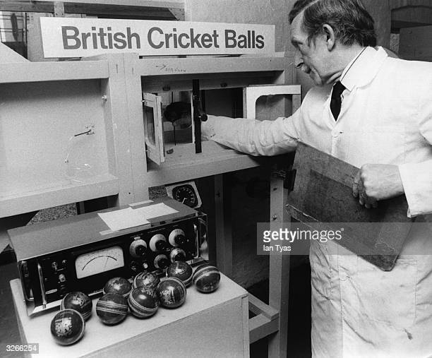 A technician at the British Cricket Balls company tests balls in a wind tunnel