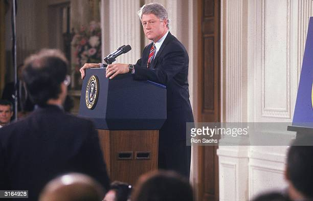 American politician and the 42nd President of the United States Bill Clinton holding a press conference in the East Room of the White House