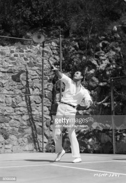 American actor John Gilbert demonstrates his tennis skills