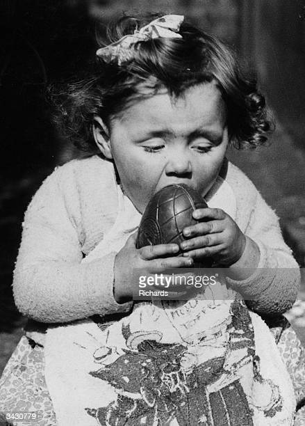 A little girl from Cardiff eating an Easter egg