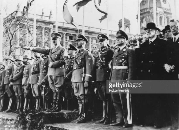 German dictator Adolf Hitler watching a parade in Munich with Chief of the German political police Heinrich Himmler and other Nazi officers.