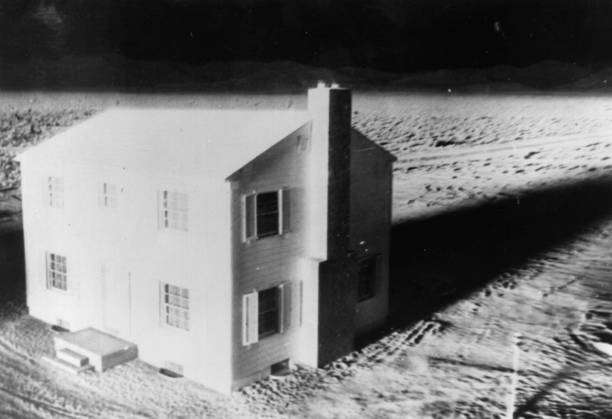 During the atom bomb tests in Nevada, a house is lit...