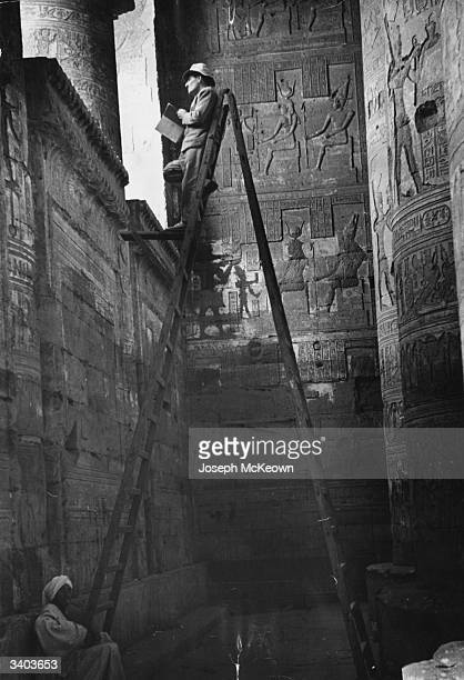 An archaeologist at work at the Dendera Temple Egypt Original Publication Picture Post 8304 Egypt Under Nasser pub 1956