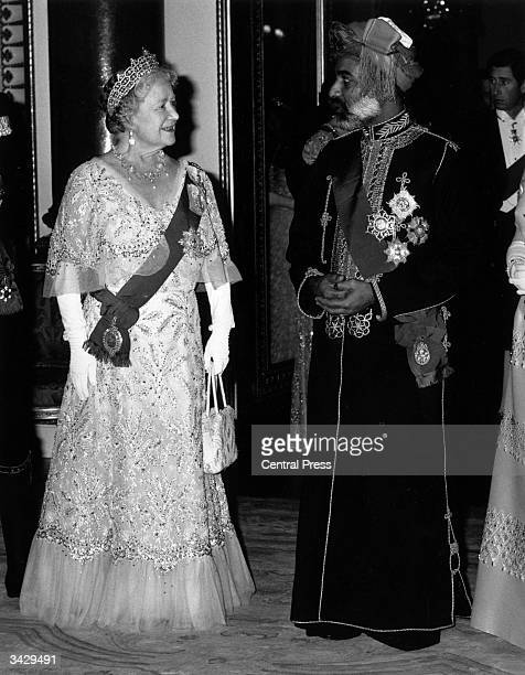 Queen Elizabeth the Queen Mother chatting with the Sultan of Oman His Majesty Qa'dos Bin Said Al Said before a banquet at Buckingham Palace Prince...