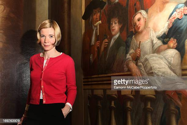 Emglish historian and curator Dr Lucy Worsley posed on the staircase of Kensington Palace in London on 17th March 2010 Behind her is a painting that...
