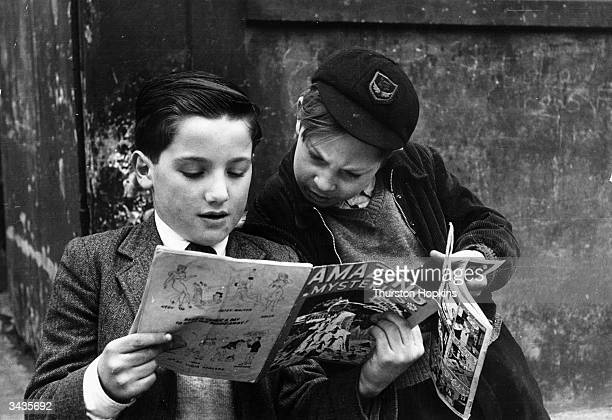 Two young boys reading comics Original Publication Picture Post 5861 Should US Comics Be Banned pub 1952