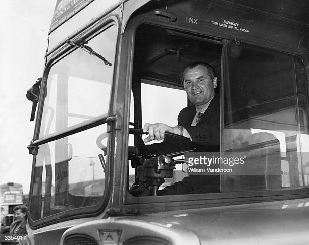 Russian bus driver Vassili Ivanovitch Loev trying a London bus on a visit to the Hammersmith works