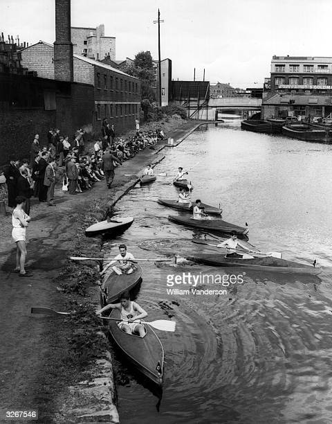 Boys of the 'Pitfield' Canoe Club push away from the banks of the Grand Union Canal at ShoreditchEast London as they begin a race
