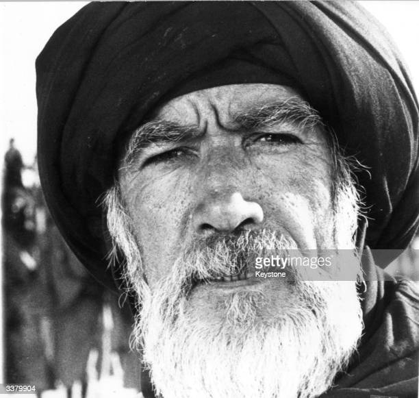 American actor Anthony Quinn in costume as an early Islamic believer in a scene from 'The Message' a film documenting the birth of Islam shot on...