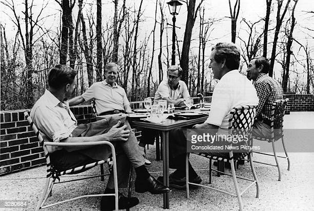 American statesman Jimmy Carter the 39th President of the United States at Camp David Maryland with members of his cabinet From left Zbigniew...