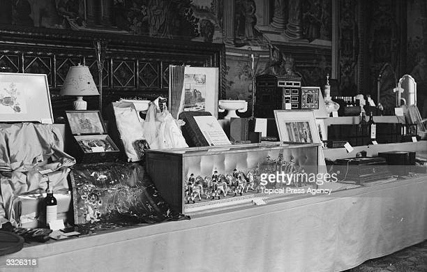 A display of the wedding presents received by Princess Elizabeth and Prince Philip at St James's Palace Among them is a model of the State Coach by...