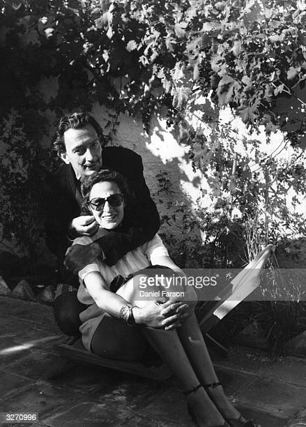 Spanish surrealist artist Salvador Dali and his wife Gala at their villa at Port Lligat near Cadaques in Spain Original Publication Picture Post 5587...