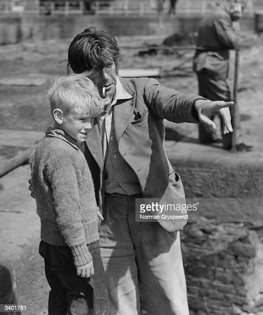 British child actor Jon Whiteley receiving direction from Charles Crichton on the set of the film 'Hunted' Original Publication Picture Post 5585...