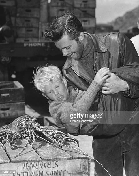 British film actor Dirk Bogarde frightening child actor Jon Whiteley with a live lobster on the set of the film 'Hunted' Original Publication Picture...