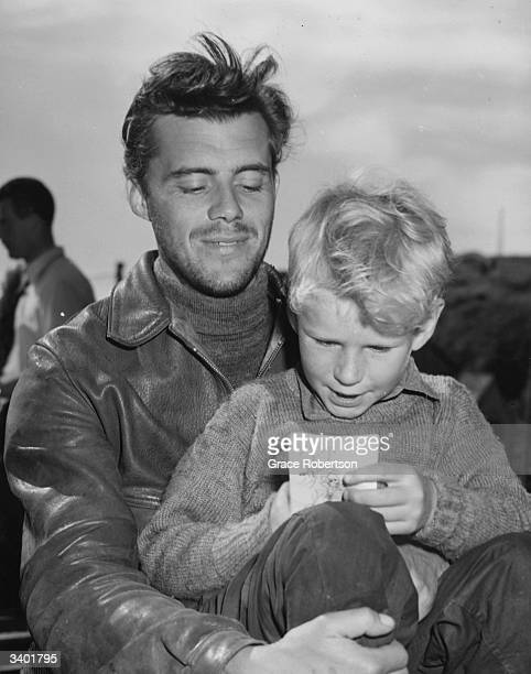 British film actor Dirk Bogarde holding child actor Jon Whiteley on the set of the film 'Hunted' Original Publication Picture Post 5585 Britain's Boy...