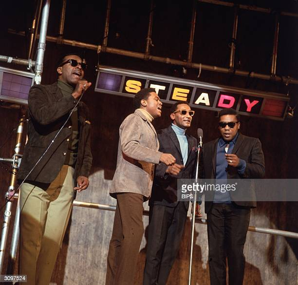 Motown group The Four Tops perform their hit single 'Standing in the Shadows of Love' on the British television programme 'Ready Steady Go'.