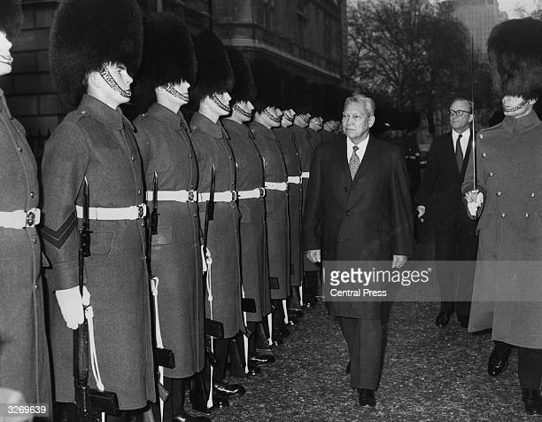 General Jesus Vargas secretary general of Seato inspecting a guard of honour provided by 2nd Battalion Grenadier Guards when he visited the ministry...