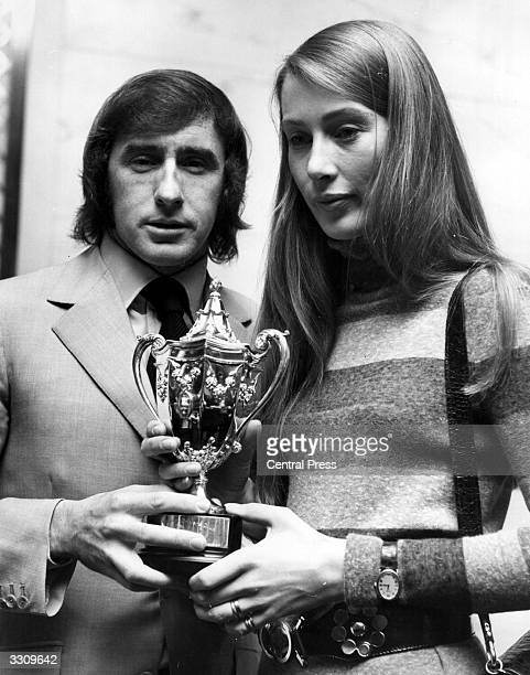 Mrs Nina Rindt receiving the racing driver's trophy from racing driver Jackie Stewart on behalf of her husband Jochen Rindt who was killed in a crash...