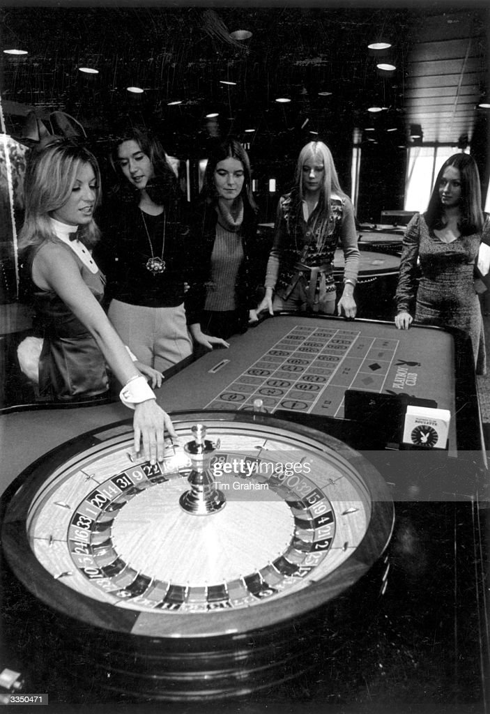 A Playboy Club Bunny Girl training prospective Bunny Girls in a casino at the London Playboy Club.