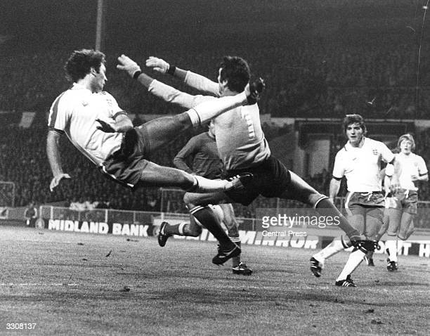 England's Ray Wilkins clashes with Italian goalkeeper Dino Zoff during the match between England and Italy at Wembley Stadium London