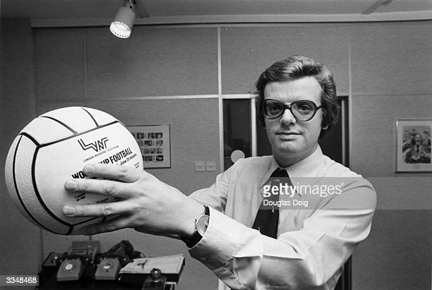 Michael Grade programme director at London Weekend Television posing with a LWT football after the announcement that ITV had secured exclusive...
