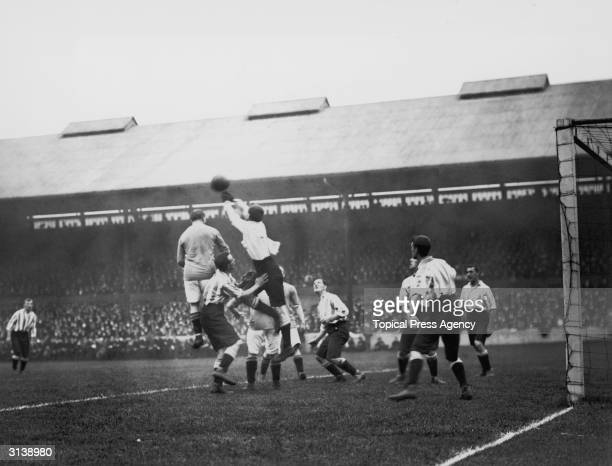 Sheffield Wednesday goalkeeper Jack Lyall jumping for the ball during a game against Chelsea
