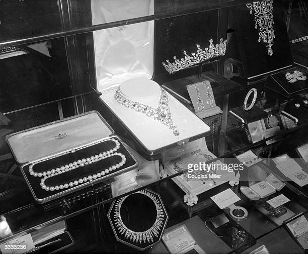 Wedding presents for Princess Elizabeth and Prince Philip on display at St James' Palace London The jewellery including necklaces and a tiara are...