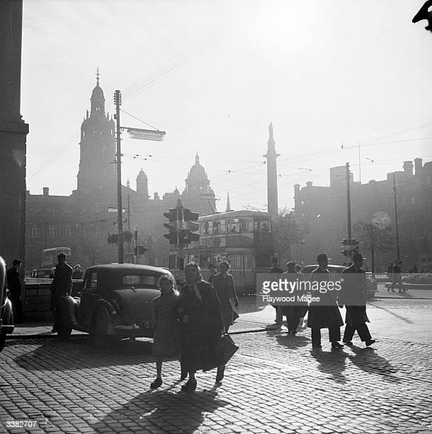 A busy crossing in George Square Glasgow In the background are the City Chambers Glasgow's City Chambers are built in Italian Renaissance style and...